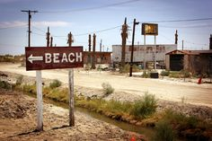 """Salton SEA, California, USA   """"There is a place where beaches are made not of sand, but of the skeletons of millions of fish. Luxury yacht clubs are now frequented only by pigeons, vacation homes lay open to the elements and RV camp grounds look more like burial grounds.""""  http://www.messynessychic.com/2012/10/03/the-apocalypse-came-early-for-the-salton-riviera-california/"""