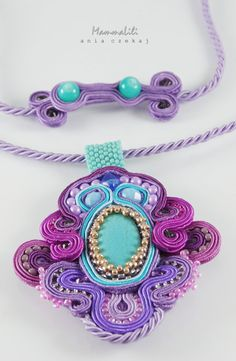 Purple and turquoise pendant The pendant is made of strings braid in the color turquoise, purple and pink. I used Toho beads, Fire Polish, crystals.In