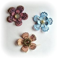 StampARTic: Use edging punch on flower tips to create beautiful flowers.