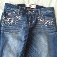 Hollister straight leg jeans Denim jeans in good condition. Rhinestones cover upper portion of the jeans. Stretch material. Hollister Jeans Straight Leg
