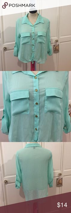 Mint button down Gently used with tarnishing to buttons. No pilling, pulls or tears. Price firm, no trades about a girl  Tops Button Down Shirts