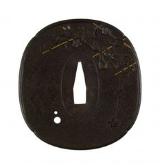 Tsuba with a Spider on a Gourd Vine Trellis. In the upper right of this tsuba is a trellis upon which a gourd vine is depicted. One gourd hangs down from the trellis near the central opening of the tsuba. At the far right, a spider hangs from a thread. On the reverse, a spider web is at the upper left. A blossoming vine on a trellis is on the left.  Hashimoto Isshi I (Japanese, 1820-1896)