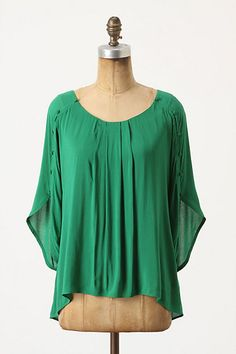 I like this color in small amounts, but I'd rather have this in orange, but still very cute. I'd wear it with some white skinny's and some sandals.