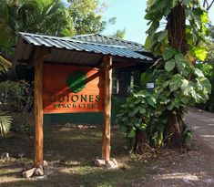 Carved and painted wood sign with wood structure with roof for Guiones Beach Club, Nosara Costa Rica Gazebo, Pergola, Nosara, Wood Structure, Painted Wood Signs, Beach Club, Costa Rica, Logo Design, Carving
