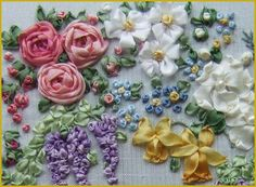 Silk ribbon embroidery. These flowers are fairly easy to learn if you already know basic embroidery stitches. Lots of books and patterns available. Love it.