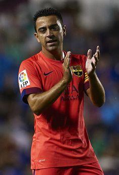 Xavi Hernandez of Barcelona reacts during the La Liga match between Levante UD and FC Barcelona at Ciutat de Valencia on September 21, 2014 in Valencia, Spain.