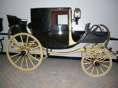 "Traveling chariot, 1815-1820. ""This type of carriage was used for long journeys, such as the Grand Tour of Europe, which every young nobleman and gentleman of substance made in the 18th and early 19th centuries. The extension on the front of the body is known as a ""dormeuse boot"". It has folding panels which can be let down to enable the inside passengers to stretch out at full length into the boot and sleep while they travelled."""