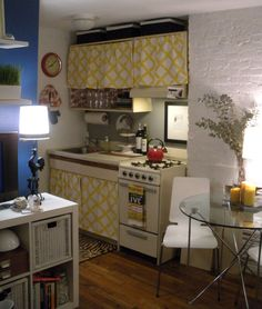 Audra kitchen after 2 091412.jpg    She removed cabinet doors and replaced with cute fabric and lined inside with floral paper.