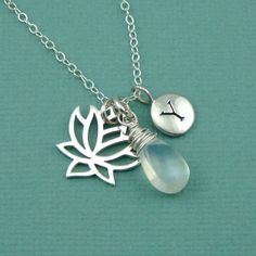 Moonstone Lotus Initial Necklace , sterling silver personalized jewelry , moonstone , hand stamped charm. $48.00, via Etsy.