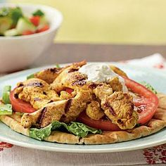 Shawarma is a Middle Eastern dish of garlicky meat or poultry served on pitas. This chicken version is flavored with a savory yogurt sauce.