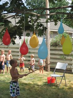 Backyard Water Party with water ballon pinatas, finger paint murals, soap mud, slip 'n slide, and water balloon fight and toss.