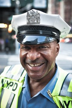 Urban Photography Idea: City Officials - Happy policeman by Raphael Jolicouer | Flickr - Photo Sharing!
