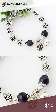 Silver Plated Rose Beaded Stretch Bracelet antiqued silver tone with 2 dangle charms...one is a rose and the other a little jingle bell Jewelry