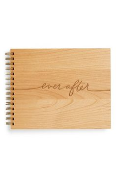 A perfect finishing touch for a rustic wedding, this handcrafted guest book features high-quality white linen pages and hand-lettered laser engraving on the sustainable American hardwood cover.