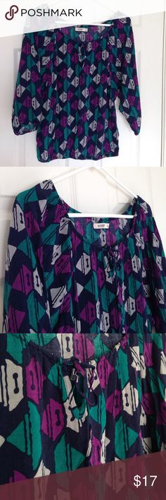 """Boho Style Top Navy, purple and teal Boho style top with v-neckline with string to tie. Elastic band at waist, neckline and end of sleeves. Lightweight. 100% rayon. No stains or holes. Measurement laying flat: bust: 18"""" length: 23"""" Old Navy Tops"""