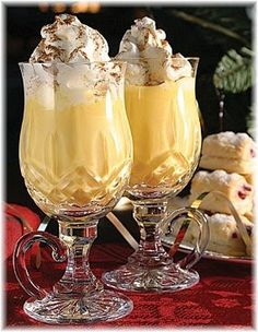 Yuletide Eggnog Recipe - 4C.milk, 5 cloves, 2 1/ 2t. vanilla extract, 1t. ground cinnamon, 12 egg yolks, 1 1/ 2C. sugar, 2 1/ 2C. light rum, 4C. light cream, 1/ 2t. ground nutmeg. YUM!!!