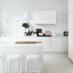 Love the subway tiles and painted floor - although it looks great white flooring is not practical in a kitchen!