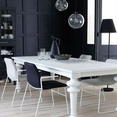 love the assymetrical pendants, dramatic black textured wall--could I dare this?