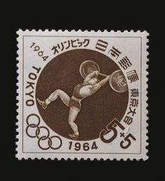Postage stamp commemorating Tokyo Olympics JAPAN - SEPTEMBER 06: Postage stamp commemorating the Tokyo Olympics, 1964, depicting weight lifting. Japan, 20th century. Japan (Photo by DeAgostini/Getty Images)