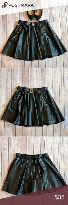 "Black Swan leather buckle skirt NWT Black Swan black leather skirt with buckle. Size 28. Excellent condition. Smoke free home. 100% polyurethane. Length: 16.5"". Waist: 14.5"". Black Swan Skirts"