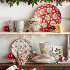 BOHEME DINNERWARE, 16-PIECE PLACE SETTING--It's said that variety is the spice of life—celebrate that thought with a ceramic dinnerware set in a mismatched medley of pattern and color. Dishwasher and microwave safe. Imported. Place setting includes four each of dinner plates, salad plates, bowls, and mugs.