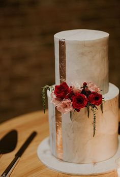 Brides: Two-Tiered Gold Wedding Cake with Roses. What goes better with a rose gold wedding cake than actual roses? Created by Sweet Bakes.