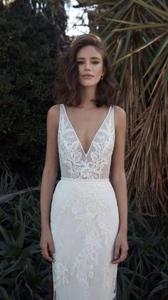 bridal Sleeveless V neckline heavily embellished bodice bohemian soft fit and flare wedding dress sweep train flora-bride #weddingdress #wedding #bride #bohemian #bohobride