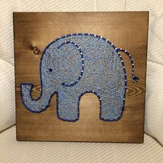 Add this cute elephant to your home! It would be a great addition to a nursery or kids room as well! Size is 11 by 11. You may choose the wood stain (espresso or gray) and string colors! A sawtooth hanger is added to every board.  Since shipping costs vary, I will refund any shipping overages if it costs less than the amount listed!  Thank you for checking out my listing! You can find more at my Etsy shop- www.KiwiStrings.etsy.com
