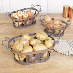 Offering fantastic quality, quintessential French farmhouse style and valuable storage. This set of three nesting storage baskets are made from heavy durable iron finished in matt antique brown and are complete with a cockerel design to the front of each. Varying in size they are in an oval shape with ornate handles for easy transportation and wooden detailing finished in a dark oak colour. Display on a kitchen worktop with this season's fresh fruit and vegetables. french country.