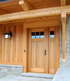 The design of a custom cedar door with a single sidelight mimics the exterior cedar paneling on a lake home. Log Cabin Exterior, Wood Exterior Door, Rustic Exterior, Cedar Door, Cedar Paneling, Entry Doors, Front Doors, Wood Doors, Barn Doors