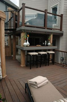 "Outdoor Kitchen Ideas - This cantilevered bar is conveniently located close to the hot tub, and sheltered by the upper deck above. Part of the ""Spiral Staircase Deck"" on ""Decked Out"". Deck Design by Paul Lafrance Design. Backyard Garden Landscape, Backyard Patio, Outdoor Rooms, Outdoor Living, Sheltered Housing, Outside Living, Decks And Porches, Deck Design, New Homes"