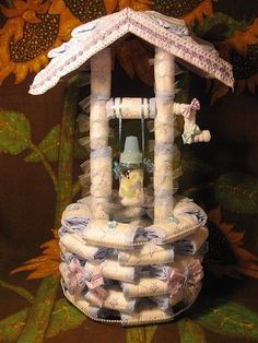 Wishing Well Diaper Cake: Talk about a scene stealer at your next baby shower. This wishing well diaper cake ($9 for the instructions) is a true centerpiece for your fete.