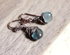 Moss aquamarine briolettes wrapped in copper wire. Viking Jewelry just for me.