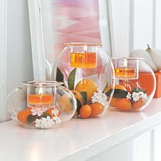 "Clearly Creative Eclectic Votive Trio Three shapely blown glass holders to fill with your own decorative touches! Top with a votive or tealight, sold separately, in the pressed glass votive cup. One each: 5¼""h, 4""h, 2¾""h. www.partylite.biz/cndlluvrs"