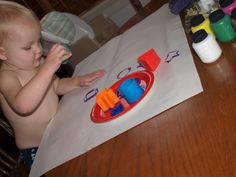 Teaching toddler shapes with shaped blocks and paint