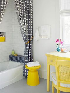 Smartly patterned fabric curtain panels stand in as shower curtains to give this bathroom a designer touch that's easy and budget friendly. Pair fabric panels with a clear plastic shower liner to block splatters. If your bathtub and flooring have seen better days, consider having the tub surface professionally refinished and opt for a new tile floor.