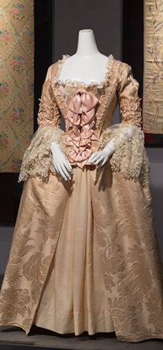 A Robe à l'anglaise with a corset, a detailed stomacher, side hoops on each hip, and an open gown. (SOURCE: http://sites.fitnyc.edu/depts/museum/Retrospective/18-Century-3.html)