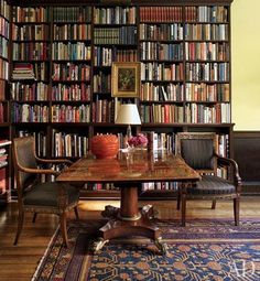 In the library, French Empire chairs flank an English Regency table | archdigest.com