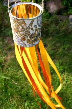 Modify this tin-can windsock.  Dangles of wire and beads for light, colour and perhaps even deter birds from veggie patch.