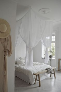 my scandinavian home: linen canopy in the bedroom of the serene home of Swedish interior stylist Denice Lindell