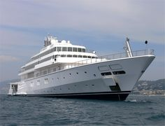 Rising Sun yacht - 138.4 meters (454.1 ft) - Built in 2004.  With its steel hull and aluminum superstructure, along with a beam that measures no less than 18.5 meters (60.7 ft) and a 5 meter long draft (16.4 ft), the Rising Sun can reach the astonishing speed of 28 knots, being able to cruise at 26 knots. It can accommodate a total of 16 guests, assisted by a crew of 45.