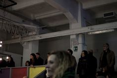 ITALY. Milan. December 6, 2015.  People attending concerts and Christmas market at BASE - a space for culture and creativity - located in the former industrial Ansaldo area, a big electromechanical plant founded in 1904.