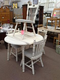 $189 - This round solid wood table has been painted white distressed and had a dark wax and applied it has a large leaf that turns it into a oval table and the chairs have new upholstery.  **** In Booth D13 at Main Street Antique Mall 7260 E Main St (east of Power RD on MAIN STREET) Mesa Az 85207 **** Open 7 days a week 10:00AM-5:30PM **** Call for more information 480 924 1122 **** We Accept cash, debit, VISA, Mastercard, Discover or American
