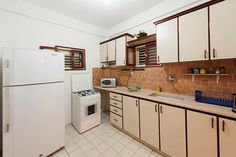 Large apartment accommodation includes 4 rooms, 2 bath, large kitchen and a huge yard
