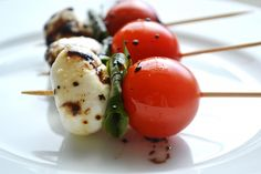 Caprese salad skewer with reduced balsamic vinegar (using sundries tomatoes is a great twist)
