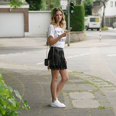 Pin for Later: Proof That a Leather Skirt Is the Most Versatile Piece a Woman Can Own With a White T-Shirt and White Kicks