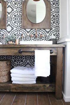 farmhouse style bathroom. decorative tile, custom wood vanity, copper accents, and a pop of greenery.