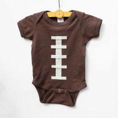 Football Onesie by WhiteFinn on Etsy my son will be in one of these!