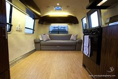 Cece and Brenda's 25' Safari Airstream trailer renovation // Lots of eco-friendly ideas like cork planks, rainwater harvesting system, composting toilet.