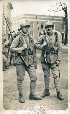 Two French Poilu of the 43e Regiment d'Infantrie posed in battle dress ready for the front. They could very well be father and son.